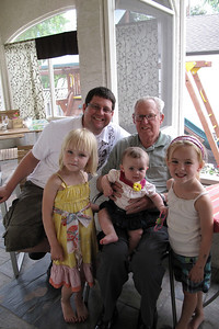 Great Grandpa Ed with the grandkids and great grandbaby