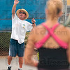 Well served:  Terre Haute North tennis coach Jim Cook describes the mechanics of a well hit serve to Brittany Farmer, foreground, during a practice session Wednesday at the school.
