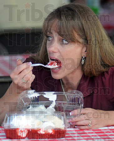 Yummy: Debbie Diethrich of Terre Haute enjoys some strawberries and ice cream during Thursday's annual Strawberry Festival.