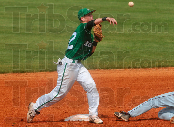 Tag and throw: West Vigo's Scott West throws the ball to first base after he forced a Brebeuf runner out at second during the Vikings' 11-6 semistate win Saturday at Avon High School.