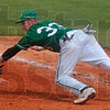 Gettin' dirty: West Vigo's Aaron Welch dives for the throw back to first base as a Brebeuf base runner tries to avoid the tag during the Vikings' 11-6 semistate win Saturday at Avon High School.