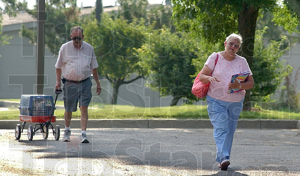 One last try: Bob and Virginia Noyd enter the Cracker Barrel parking lot Wednesday evening in an attempt to find their lost cat Katie. Katie had to be left behind last year when she became lost in the nearby Econo Lodge the Noyds were staying in.