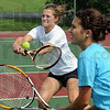 Double trouble: Terre Haute South #1 doubles team of Mallory Metheny (L) and Emma Bilyeu prepare for state finals action during Thursday's practice at the school.