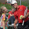 Chin check: Terre Haute South tennis coach Bill Blankenbaker checks the chin of Alexis Summers after she was hit in the face with the ball during Thursday's practice at the school. Alexis plays #2 doubles with her partner Eesha Purohit.