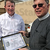 Thanks: Rev. Chip Chillington thanks Bob Baesler for helping people in need Thursday morning.