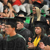 Tribune-Star/Joseph C. Garza<br /> She didn't miss a minute: West Vigo High School graduate Brittani McCalister reacts to the applause from her fellow classmates after she was recognized as a student who never missed a day of school Sunday during the school's graduation in West Terre Haute.