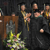 Tribune-Star/Joseph C. Garza<br /> To a standing ovation: West Vigo High School graduate Kyle Ellis can't help but smile as she walks across the stage to accept his diploma Sunday during the school's commencement ceremony in West Terre Haute.