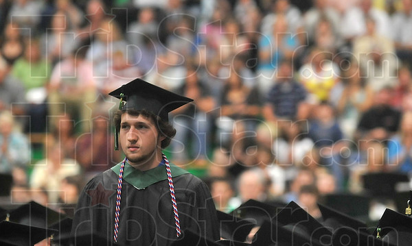 Tribune-Star/Joseph C. Garza<br /> Go Army: West Vigo High School graduate Adam Millar stands to be recognized for his impending service in the U.S. Army during the school's commencement ceremony Sunday in West Terre Haute.