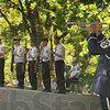 Tribune-Star/Joseph C. Garza<br /> Salute and remember: Retired U.S. Air Force Command Chief Master Sgt. Jim Chesterson plays taps as the VFW Post 972 honor guard salutes during a Memorial Day ceremony at Highland Lawn Cemetery Sunday.