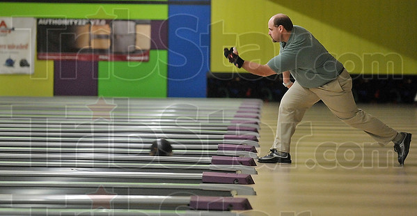 Championship form: Richard Kidd of El Paso, Ill., warms up before his championship game against Sean Swanson of Springfield, Mo., during the Greater Terre Haute Open Sunday at the Terre Haute Bowling Center.