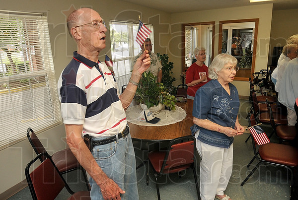 Tribune-Star/Joseph C. Garza<br /> Songs of freedom: Anthony Square residents Bill Oeding and Wanda Wildin sing patriotic songs with their neighbors during a Flag Day ceremony Sunday at the senior citizen home.