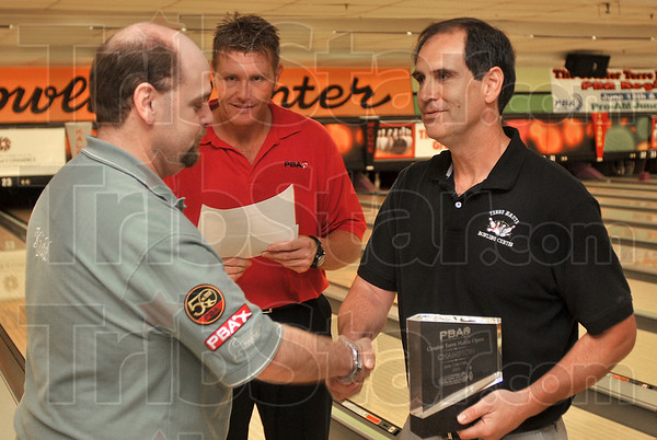 Tribune-Star/Joseph C. Garza<br /> A new PBA winner: Richard Kidd of El Paso, Ill., is congratulated by Terre Haute Bowling Center manager Phil Cooper after Kidd won the Greater Terre Haute Open Sunday at the bowling alley. Looking on in the background is Bobby Jakel of the PBA.