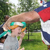 Tribune-Star/Joseph C. Garza<br /> William Herndon, 9, receives a custom-made and custom-fit balloon hat from Sheriff Woody, a.k.a. Larry Black, at Family Day Sunday at St. Mary-of-the-Woods.