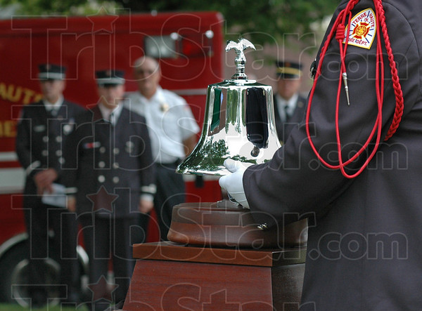 For whom the bell tolls: A Terre Haute fire department honor guard members rings the bell after the reading of each name of firefighters and police officer who lost their lives in the line of duty.