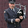 Piper: Terre Haute fire department Captain Steve Yelich plays the bagpipes during Sunday's fallen heroes ceremony.