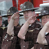 Salute to fallen: Vigo Co. Sheriff's deputies (L to R) Steve Meng, Chief deputy Jake Compton, Sean Trevarthan, Bob Bartlett and Tom Ewing salute during a fallen heroes ceremony at the Police and Fire Museum Sunday afternoon.