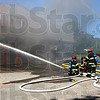 Sunday fire: Terre Haute firefighters pour water into the Family Dollar store on Poplar street Sunday afternoon.