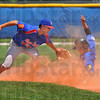 Dusty fields: Wayne Newton's Jacob Hayes tags Muncie baserunner Bryce Cook out attempting to steal.
