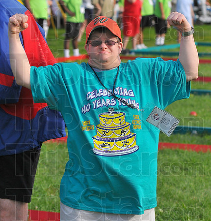 Celebrating: Bill Kibble of Porter County mugs for the camera as he competes in the Special Olympics bocce  ball tournament Sunday at Marks Field on the Indiana State University campus in Terre Haute. His t-shirt takes note of this being the 40th aniversary of the founding of Special Olympics by two ISU professors.