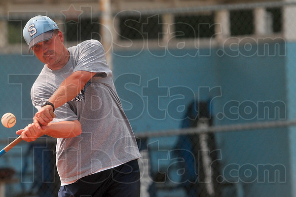 Tribune-Star/Joseph C. Garza<br /> Readying for semi-state: Shakamak coach Matt Fougerousse hits the ball to his outfield during team practice Tuesday in Jasonville.
