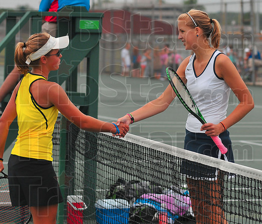 Nice game: Terre Haute North's Brittany Farmer, right receives congratulations from her opponent Bethany Moore after their match Friday afternoon in Indianapolis.