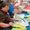 Tribune-Star/Joseph C. Garza<br /> United in action: Indiana State employee Anita Gabbard helps with the assembling of Success by Six packets as part of the United Way's Day of Action Friday at Head Start.