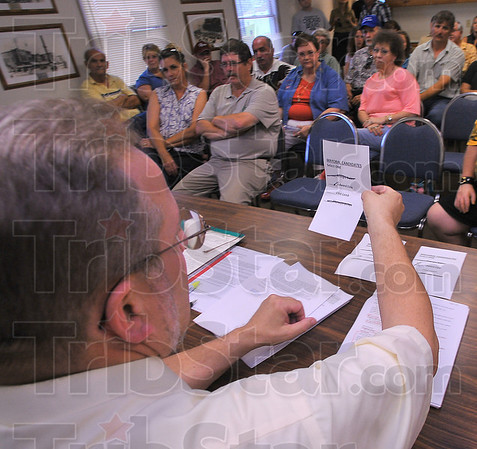 One more: Sullivan city attorney John Elmore reads Edward Eble's name from a cast ballot. Eble was eventually chosen the new mayor by County chairwoman Lynn Hamilton, who cast the tiebreaking vote.