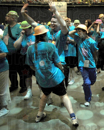 Dancers: A group of athletes break into spontaneous dancing during the opening ceremonies of the 40th annual Special Olympics event at Hulman Center Friday night.