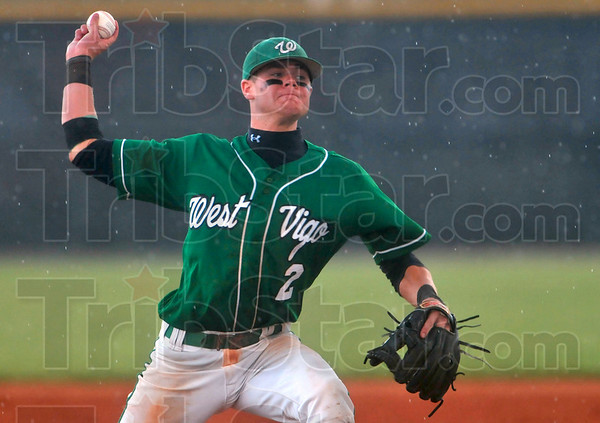 Rain or shine, he'll deliver: West Vigo's Jordan Pearson pitches through the rain, during the Vikings' 11-6 semistate win over Brebeuf Saturday at Avon High School.