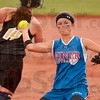 One down, let's get another: Linton's Savannah Mason tries to throw out a Madison-Grant opponent at first base after tagging out the Argyles' Dana Runyan (14) Saturday during the Class 2A state softball championship in Indianapolis.