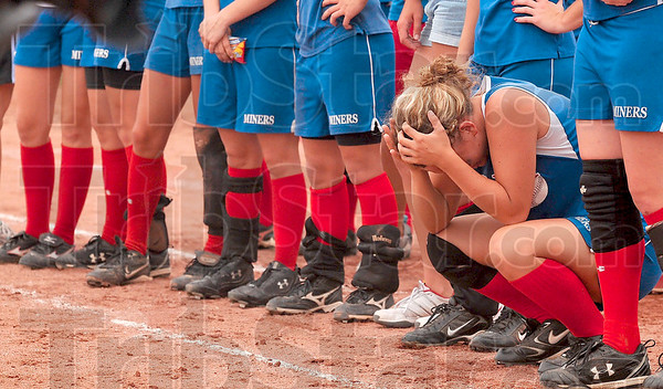 So close: Linton's Darien Huffman feels the Miners' close and heartbreaking loss after they lost 1-0 to Madison-Grant Saturday in the Class 2A state softball championship in Indianapolis.