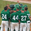 Big homer: West Vigo's Jeremy Lucas is congratulated by his teammates after he hit a three-run homerun during the Vikings' semistate win over Brebeuf Saturday at Avon High School.
