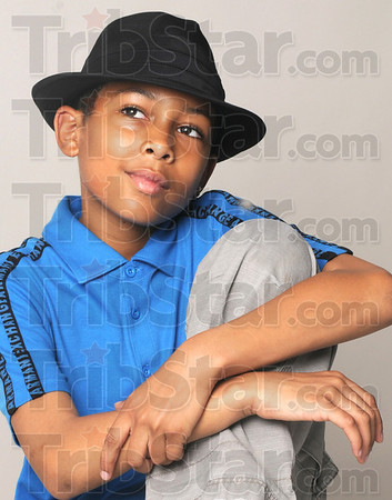 Smoothe: Isaiah Pittman poses for photographs in the Tribune-Star Studio Thursday afternoon. He's recorded a single on CD and is an accomplished tap dancer.
