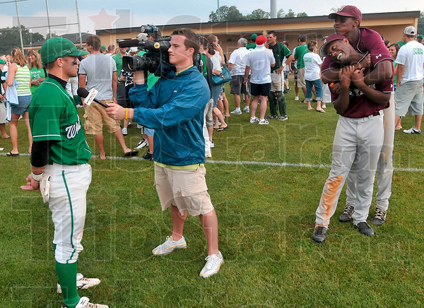Nerves of steel: West Vigo's Cameron Fagg ignores Brebeuf's Steve Eberhardt and Kevin Simms as they try to crack up Fagg during an interview after the Vikings' Class 3A baseball semistate win Saturday at Avon High School.