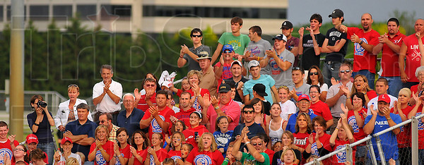 Crowd pleaser: Linton fans show their appreciation after their girls softball team put up two more runs in a 5-run fifth inning outburst.