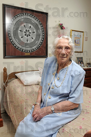 Tribune-Star/Joseph C. Garza<br /> In honor of Abe: Dorothy Higgs proudly displays the doily she made around 1940 in her room at the Cannon Inn Wednesday. The doily is called a Lincoln doily in reference to President Abraham Lincoln.