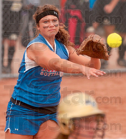 Beating the bunt: Linton's Stephanie Fougerousse throws out a Madison-Grant batter after the batter bunted Saturday during the Class 2A state softball championship Saturday at Ben Davis High School in Indianapolis.