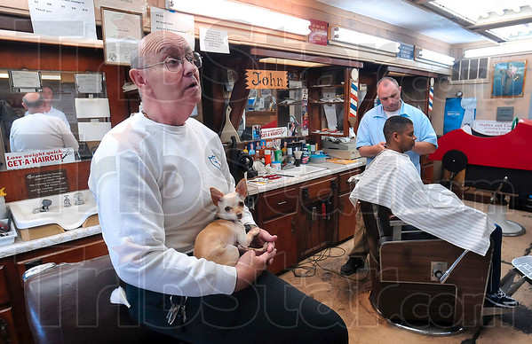 Tribune-Star/Joseph C. Garza<br /> Loyal customers: Art Stadler talks about the loyal customer base he and his son, John Stadler, have built over the years as he waits for another customer to come in Monday at 1919 Maple Avenue as John cuts customer Kelvin Mays' hair.
