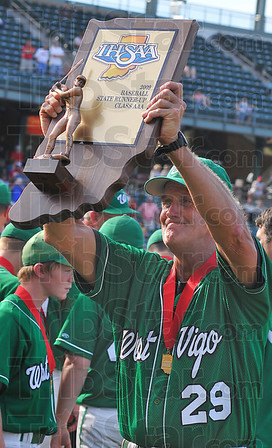 Coach: West Vigo head baseball coach Steve DeGro0ote hoists the runner-up plaque after their game with Andrean.