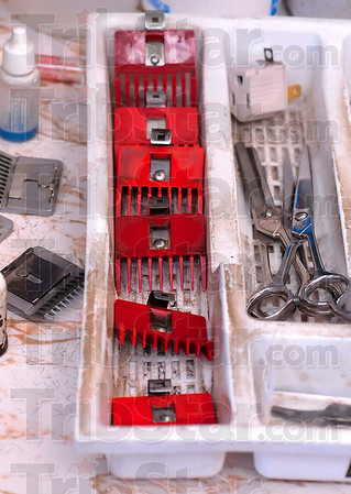 Tribune-Star/Joseph C. Garza<br /> Tools of the trade: Clipper guards and shears wait to be used to trim up the next customer at Stadler Barber Shop Monday.