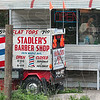 Tribune-Star/Joseph C. Garza<br /> Haircuts with history: Art Stadler can be seen in the front window of his shop at 1919 Maple Avenue  Monday. The building Stadler owns has been a barber shop since it first opened its doors around 1900.