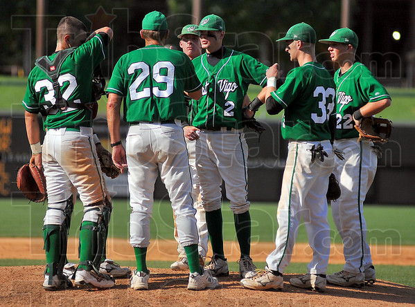 Gut check: West Vigo head baseball coach Steve DeGroote(29) makes his only trip to the mound to talk with his players after Jordan Pearson gave up a homerun.
