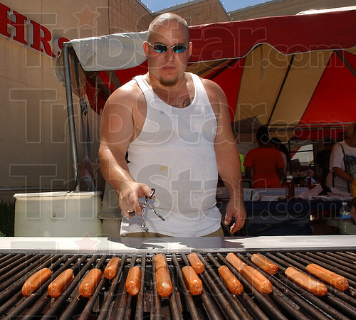 Free to good home: Ryan Littleton grills hot dogs at the drinking awareness event Saturday afternoon. Littleton's fiance Michelle Slater was the organizer of the event.