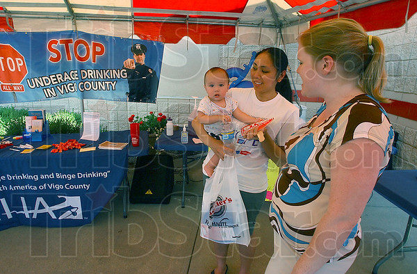 Early warning: Event organizer Michelle Slater, right, chats with  Camille Webster at  the drinking awareness event Saturday afternoon at Baesler's Market. With Webster is her son Jack.