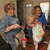 Tribune-Star/Joseph C. Garza<br /> Laughter after the flood: Flood victim Christi Reinig shares a laugh with her sister, Meghan Hadley, as they play with 14-month-old  niece, Lakyn Hadley, at Reinig's home Friday. After being displaced by the June 2008 flood, Reinig has made the most of the situation while living in a FEMA trailer but is ready to move back to her home in Prairie Park subdivision.