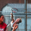 Staying in the match: Terre Haute South's Alexis Summers serves over teammate Eesha Purohit during their No. 2 doubles match against Munster Saturday in the state tennis tournament in Indianapolis.