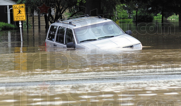 Tribune-Star file photo/Bob Poynter<br /> Submerged: A vehicle sits along US 41 in the Southwood subdivision Saturday afternoon as waters continue to rise in the area.