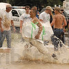 Tribune-Star file photo/Jim Avelis<br /> Help is coming: Tony Wyrick runs through the rising waters of Sugar Creek with sand bags to fill for the volunteers that showed up Saturday, June 7, 2008. At one point, over 150 men and women were at work trying to hold back the flood waters.