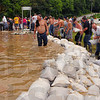 Tribune-Star file photo/Jim Avelis<br /> Stem the tide: Volunteers build a wall of sandbags across US 40 west of West Terre Haute Saturday, June 7, 2008.