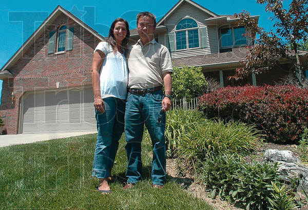 Tribune-Star/Bob Poynter<br /> Higher ground: Lisa and Peter Duong remember all too well the terrifying experience of June 2008's flash floods and now live on higher ground in the Idle Creek subdivision.